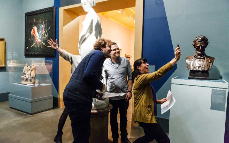 A team on a scavenger hunt at the Brooklyn Museum.